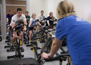 BYU students participate in a spin class in the Richards Building. Photo by Elliott Miller
