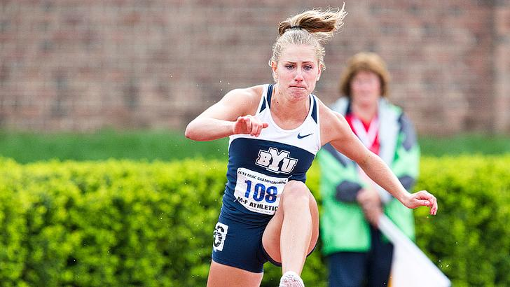 Angela Shields participates in the 400 hurdles at the Robison Invitational. Photo courtesy BYU photo