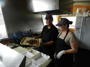 Much of the authenticity that people experience is due to the employees, such as these at Brassas Mexican Grill, who are from Mexico. (Jeffrey Allen)