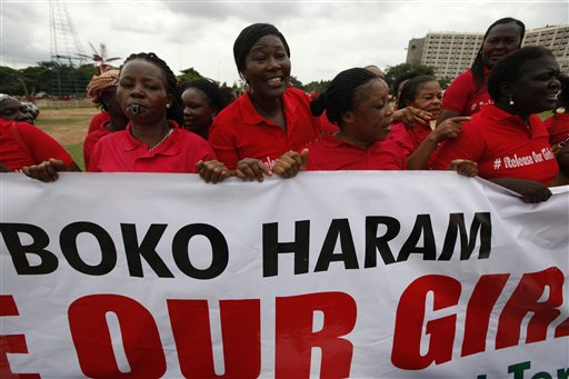 Women sing slogans during a demonstration calling on the government to rescue the kidnapped girls of the government secondary school in Chibok, in Abuja, Nigeria, Wednesday, May 28, 2014. Apparent disagreement has emerged between Nigeria's military chiefs and the president over how to rescue nearly 300 schoolgirls abducted by Islamic extremists, with the military saying use of force could get the hostages killed and the president reportedly ruling out demands for a prisoner exchange. (AP Photo/Sunday Alamba)