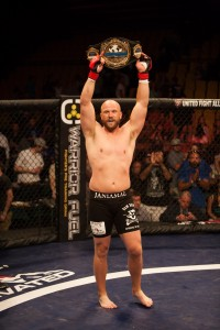 Jan Jorgensen raises his title after defeating Ben Fuimaono in the first round of their Heavyweight fight. (Courtesy Elliot Miller).