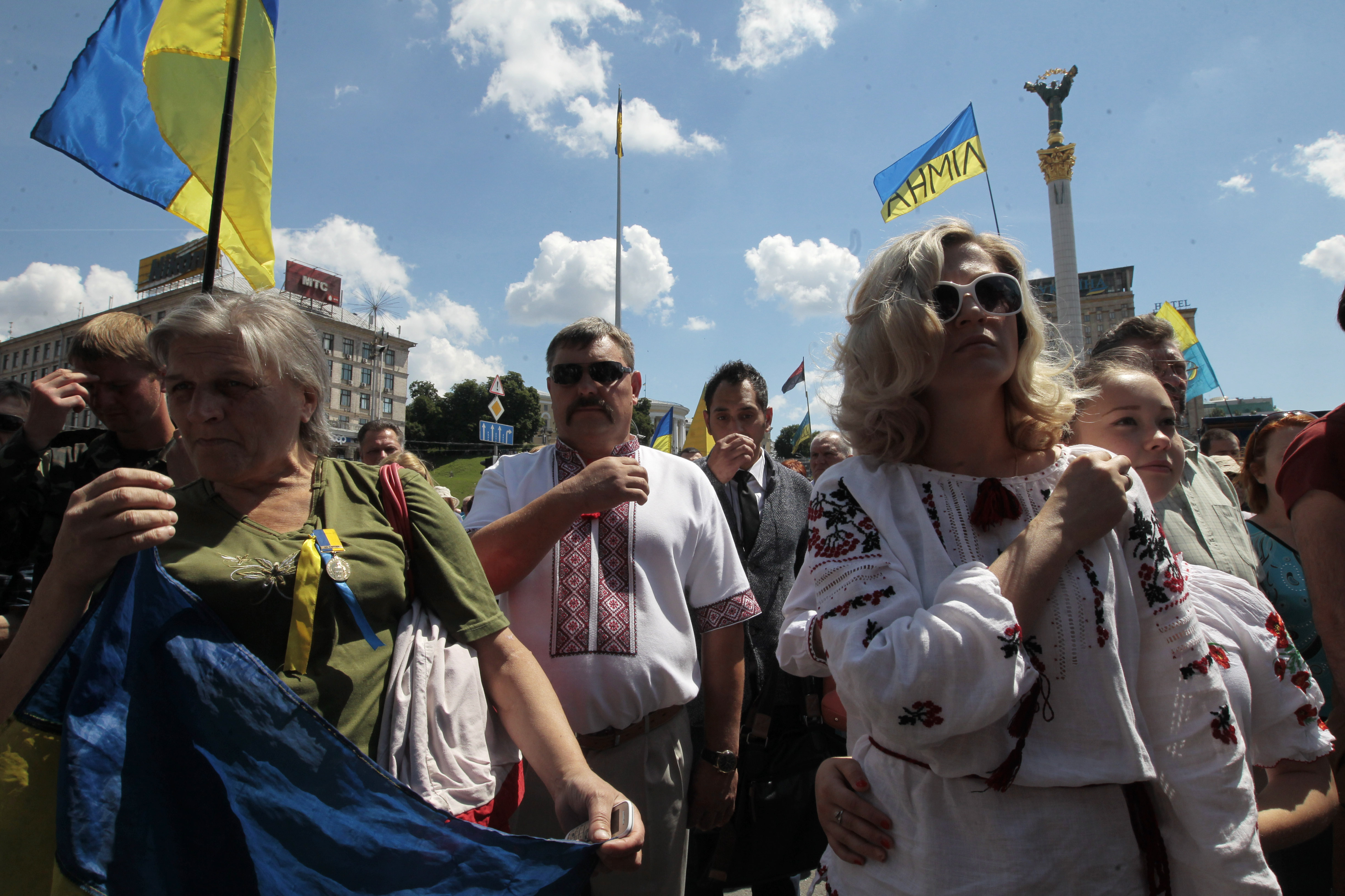 People pray during a rally in Independence Square in Kiev, Ukraine, Sunday, June 29, 2014. Hundreds of people have come on Sunday morning to the presidential administration to demand a stop to the cease fire on the eastern part of Ukraine. According to soldiers of the Donbass battalion, the other side hasn't stopped attacks and around 20 soldiers were killed during the last week that suppose to be a pause in active fighting. (AP Photo/Sergei Chuzavkov)