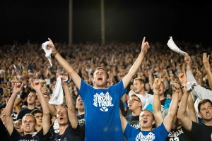 """Fans celebrate the Cougar's victory over the Texas Longhorns by cheering and singing the """"Cougar Fight Song"""", a tradition upheld since 1946. (Sarah Hill)"""