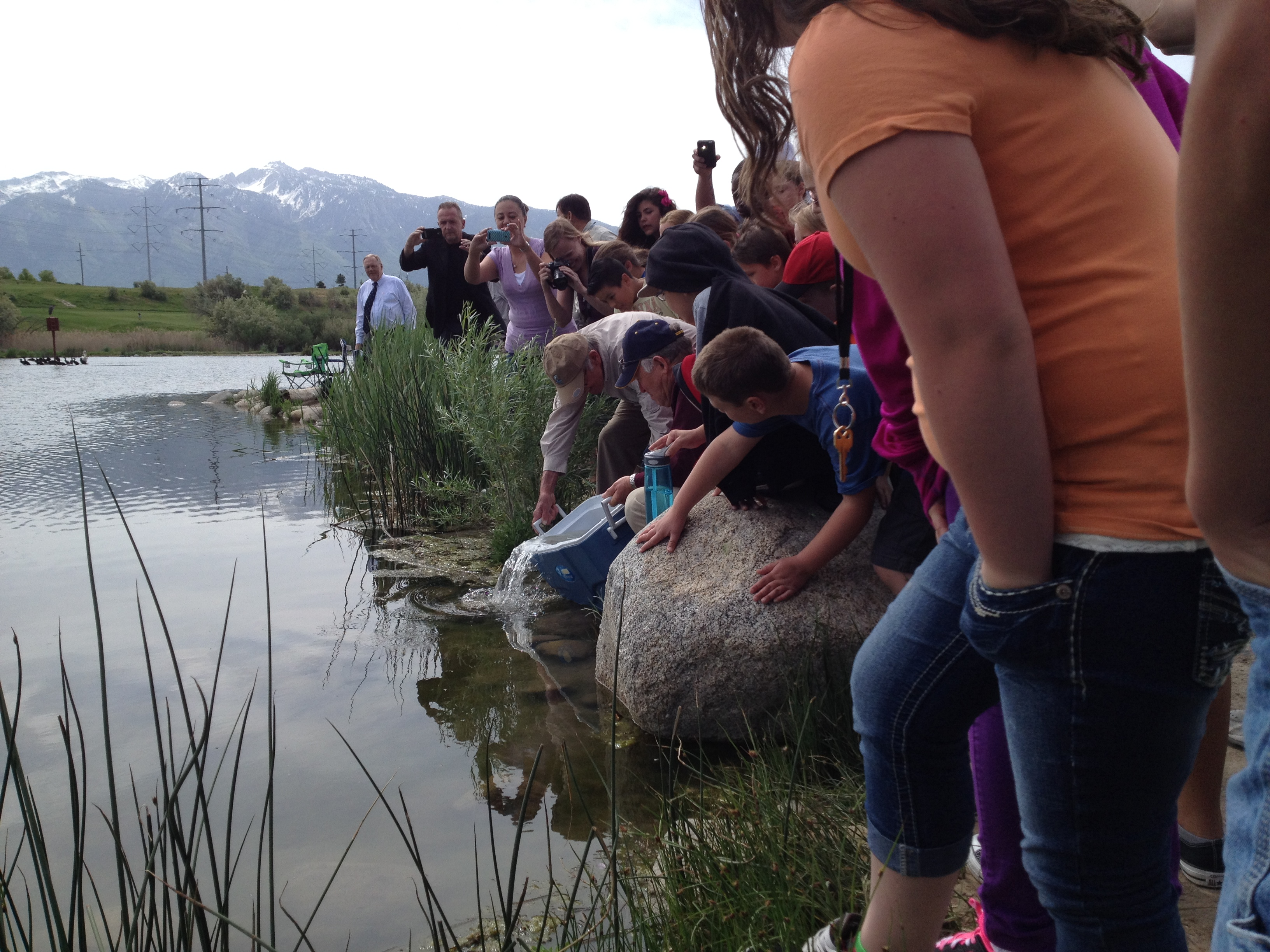 Fremont elementary school students release trout the for Taylor fish farm
