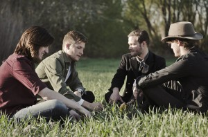 Brumby's band members discuss ideas for upcoming songs. They debate everything about an idea before settling. (Laurel Hulme Photography)
