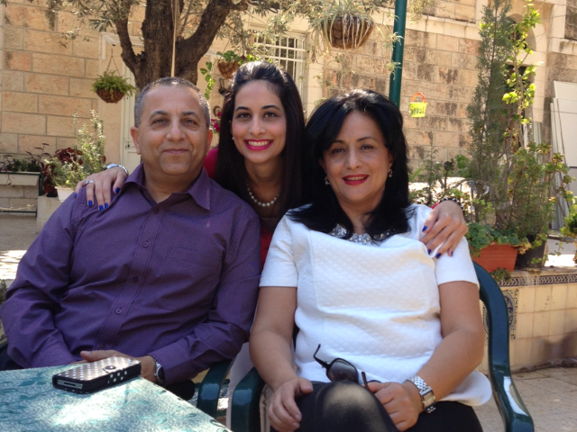 Mira Ansari (center) with her father Nazir (left), and mother Wataa (right) in a courtyard near her home in Palestine, Israel. (Mira Ansari)