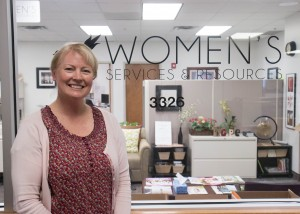 Pam Smith of BYU's Women's Services & Resources poses in front of her office in the Wilkinson Center.