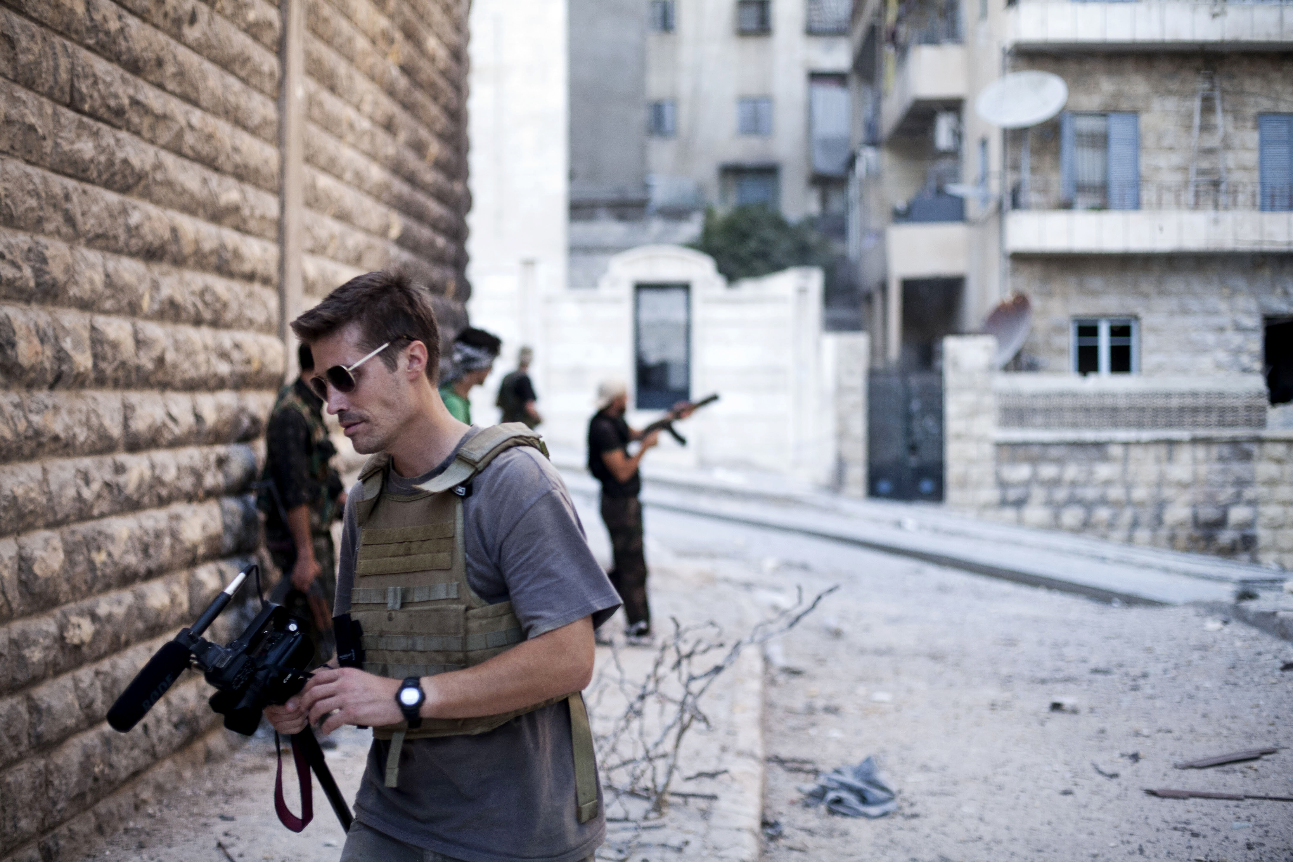 This September 2012 file photo posted on the website freejamesfoley.org shows journalist James Foley in Aleppo, Syria.In a horrifying act of revenge for U.S. airstrikes in northern Iraq, militants with the Islamic State extremist group have beheaded Foley — and are threatening to kill another hostage, U.S. officials say. (AP Photo/freejamesfoley.org, Manu Brabo)
