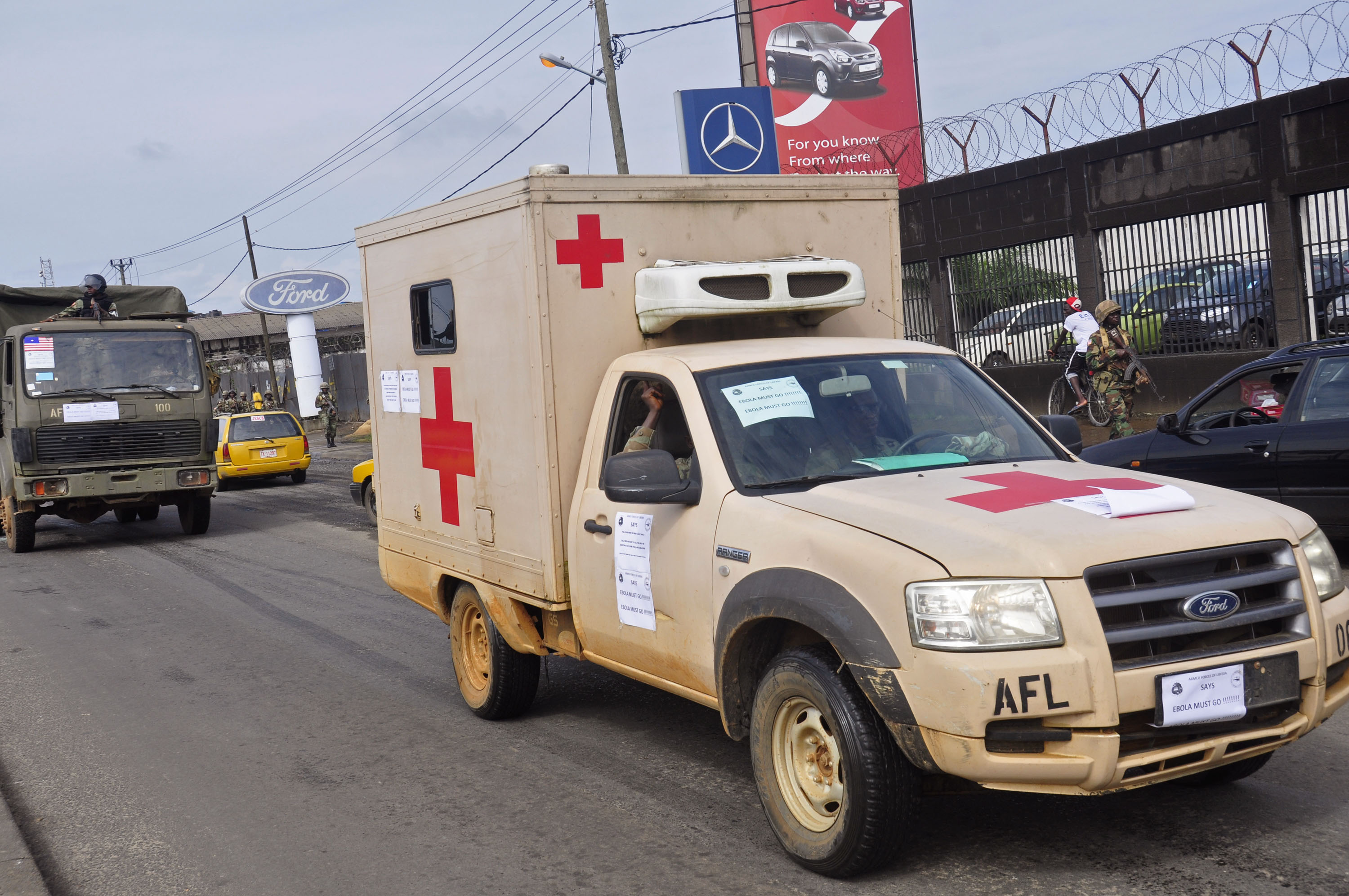 Liberian soldiers in a medical truck, with papers on it reading 'EBOLA MOST GO' on Friday, Aug 1, 2014. U.S. health officials warned Americans not to travel to the three West African countries hit by the worst recorded Ebola outbreak in history. The first case of Ebola was confirmed in the U.S. this week, but officials are saying there's no need to panic. (AP Photo/Abbas Dulleh)