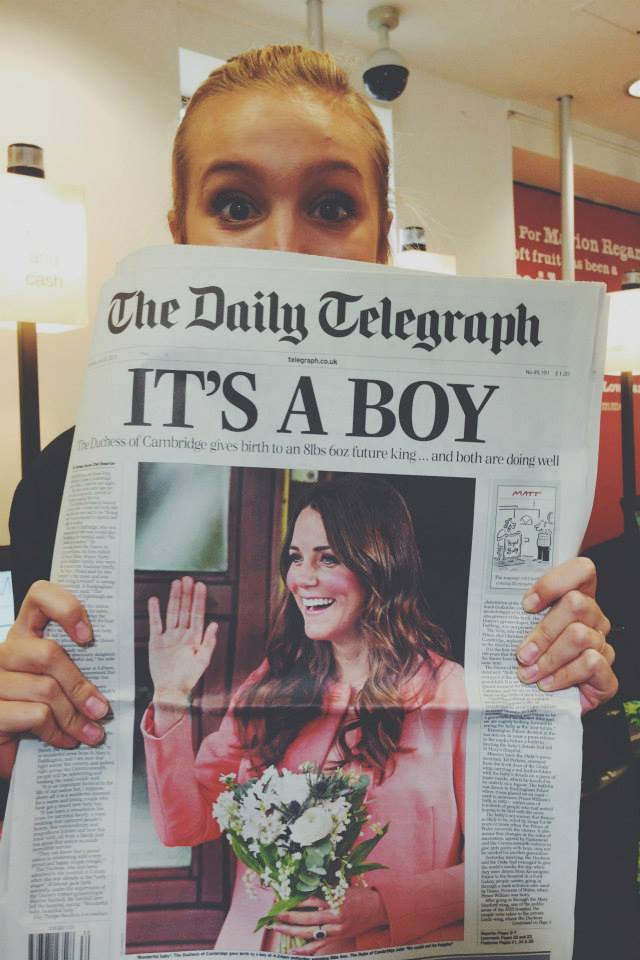BYU London Centre student Zoë Hale peeks over her copy of the Daily Telegraph, July 23, 2013. Zoë and her four roommates witnessed the royal family leave the hospital with newborn George during their semester abroad. (Photo courtesty of Zoë Hale)
