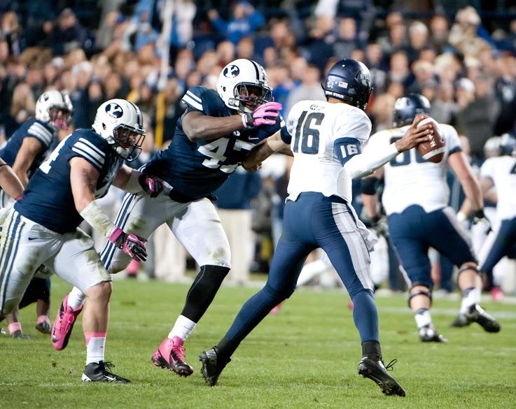 BYU defensive lineman Ezekiel Ansah puts pressure on Chuckie Keeton. (Luke Hansen)