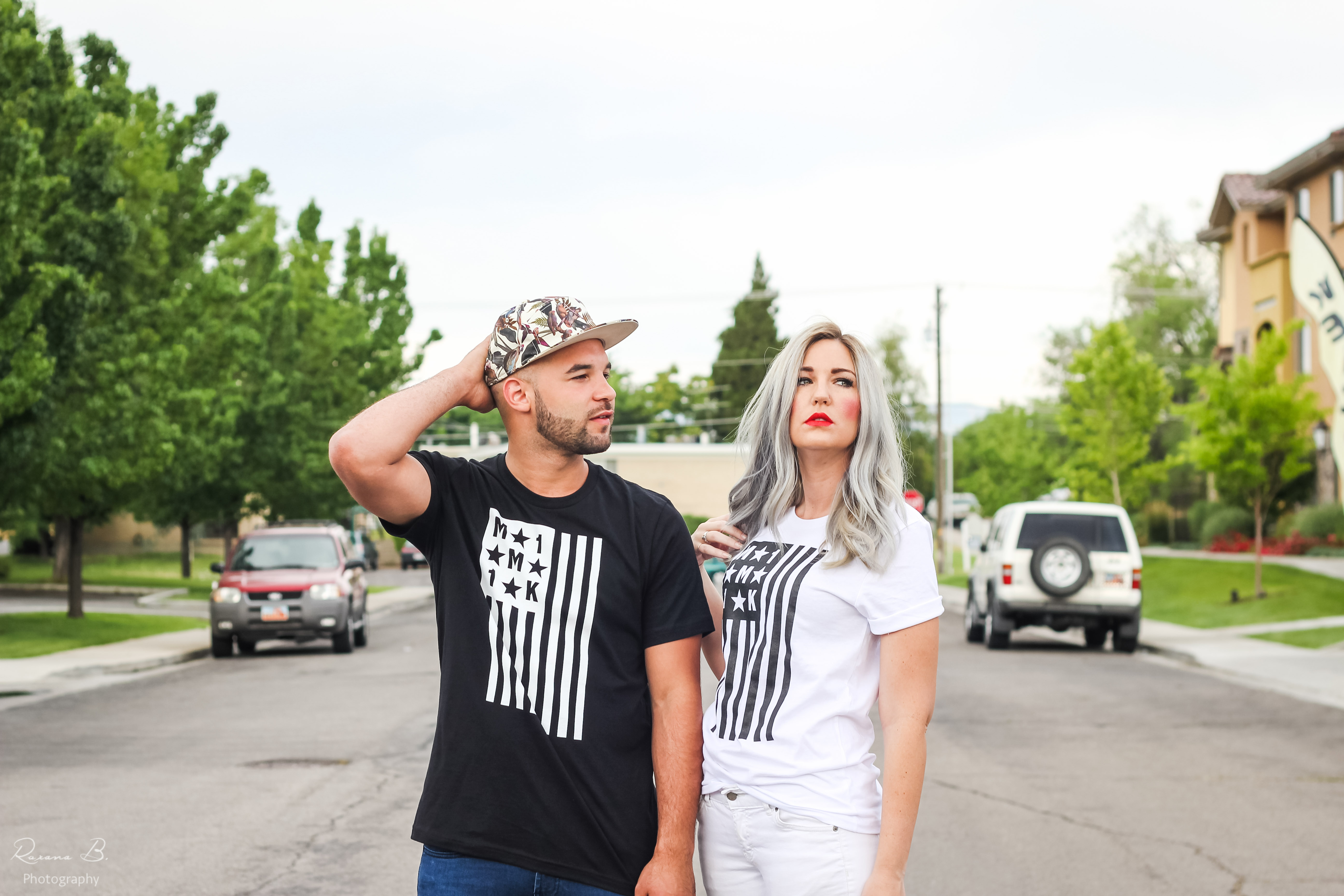Mimi Knowles and Tara Brooke, designers behind  M1M1K, wearing shirts from their clothing line. (Photo by Roxana Baker)