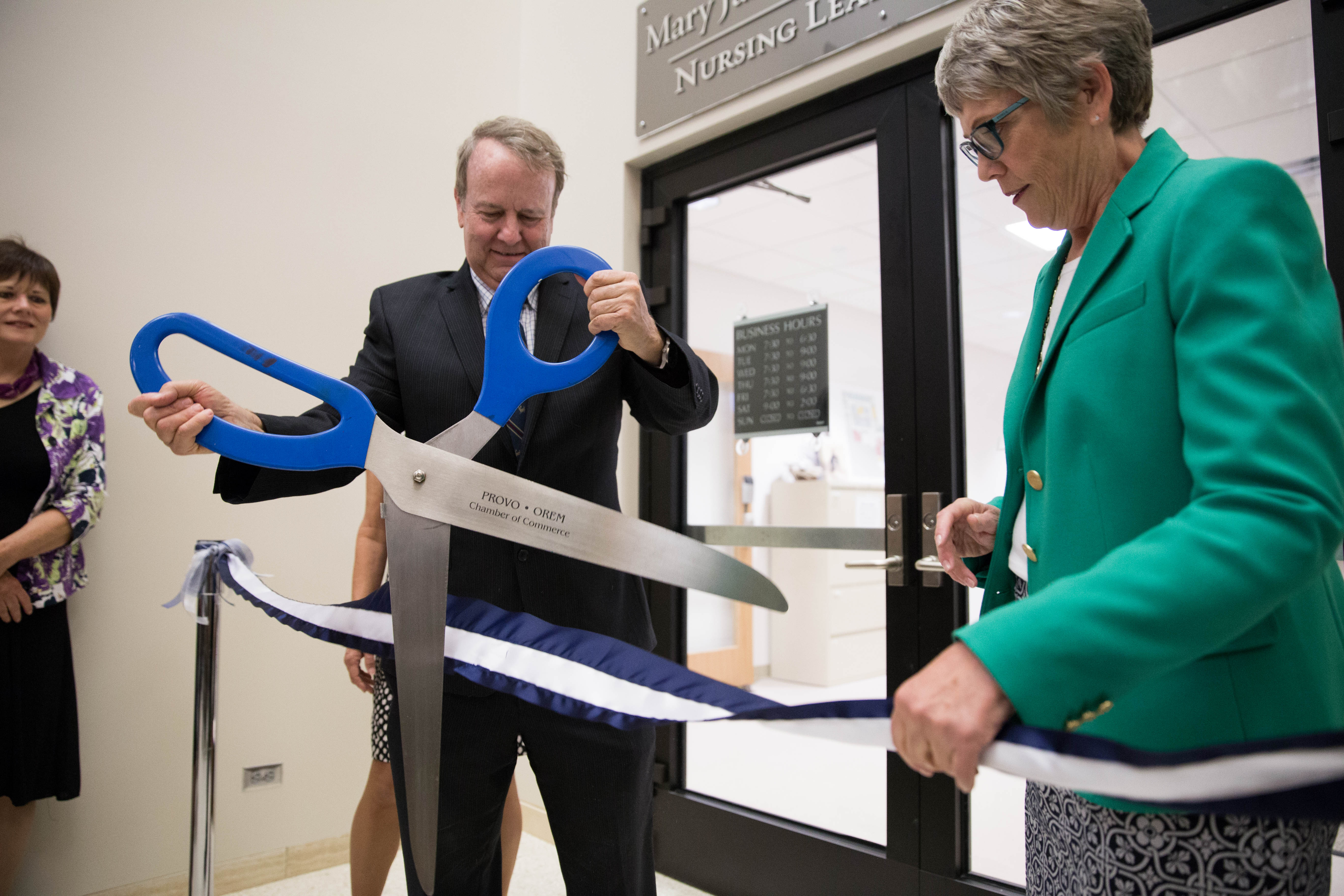 Rex Rawlinson cuts the ribbon for the formal opening of the Mary Jane Rawlinson Geertsen Nursing Learning Center. (Elliot Miller)