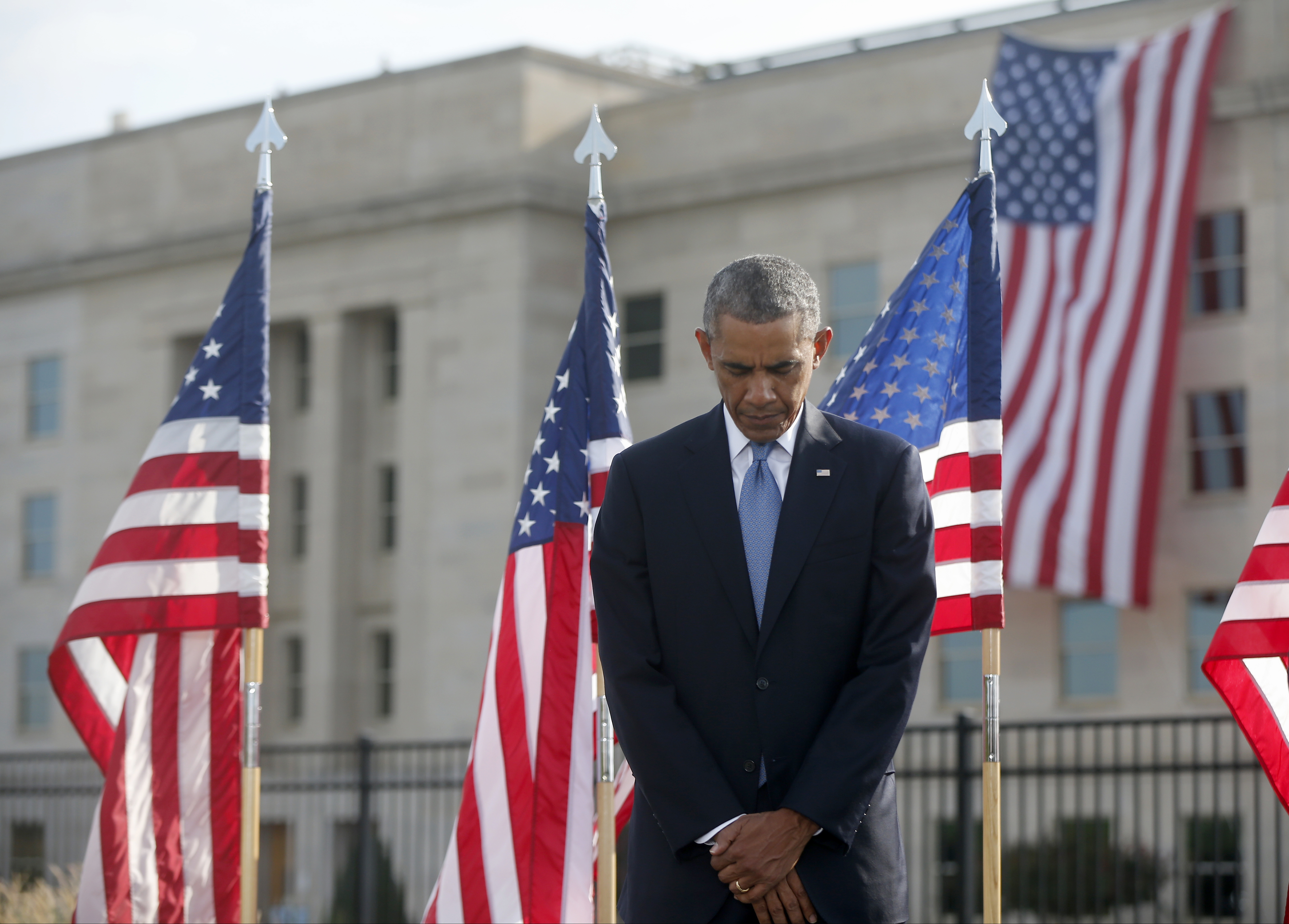President Barack Obama pauses at the Pentagon, Thursday, Sept. 11, 2014, during a ceremony to mark the 13th anniversary of the 9/11 attacks. (AP Photo/Charles Dharapak)