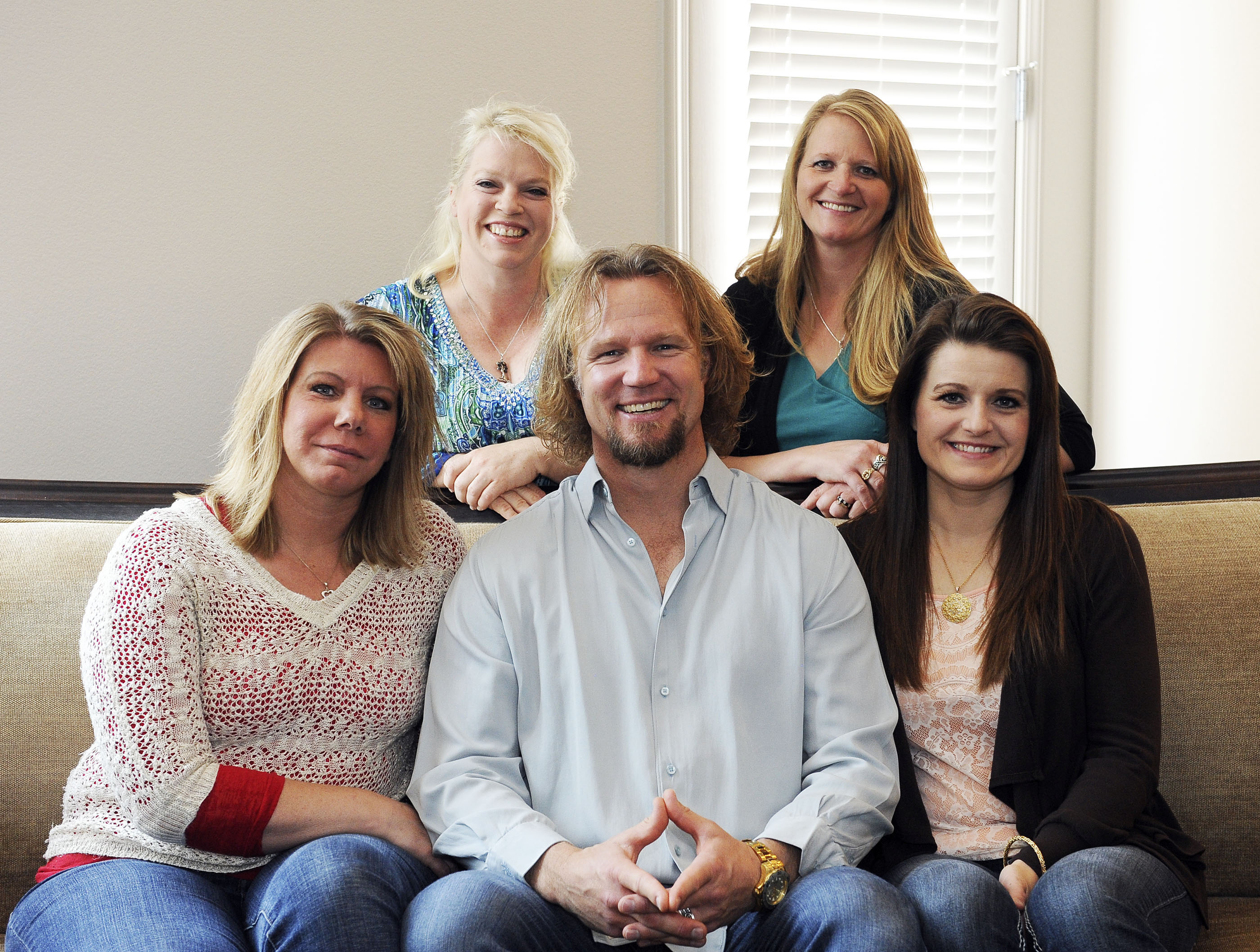 "FILE - In this July 10, 2013, file photo, Kody Brown poses with his wives at one of their homes in Las Vegas. Utah's attorney general has filed notice that he will appeal a ruling striking down parts of the state's anti-polygamy law in a lawsuit brought by the family on the TLC reality TV show ""Sister Wives."" Attorney General Sean Reyes filed the notice Wednesday, about a month after a federal judge issued a final ruling in the case. (AP Photo/Las Vegas Review-Journal, Jerry Henkel, File)"