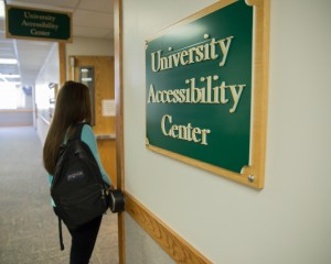 A student walks into the University Accessibility Center. The center provides added help to students with disabilities or illness.