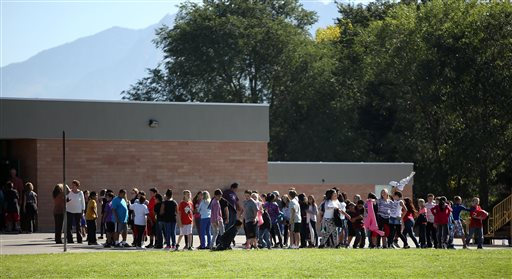 udents line up to go back inside after recess at Westbrook Elementary School in Taylorsville, Utah, Thursday, Sept. 11, 2014. Earlier, a teacher accidentally shot herself in the leg, while alone in a faculty bathroom, shortly before school started. (AP Photo/The Deseret News, Kristin Murphy)  SALT LAKE TRIBUNE OUT;  MAGS OUT