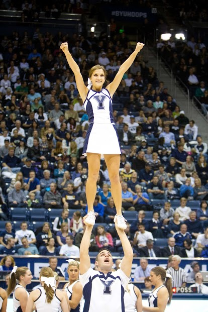 BYU cheerleaders perform stunts at a basketball game. (Universe Photo)