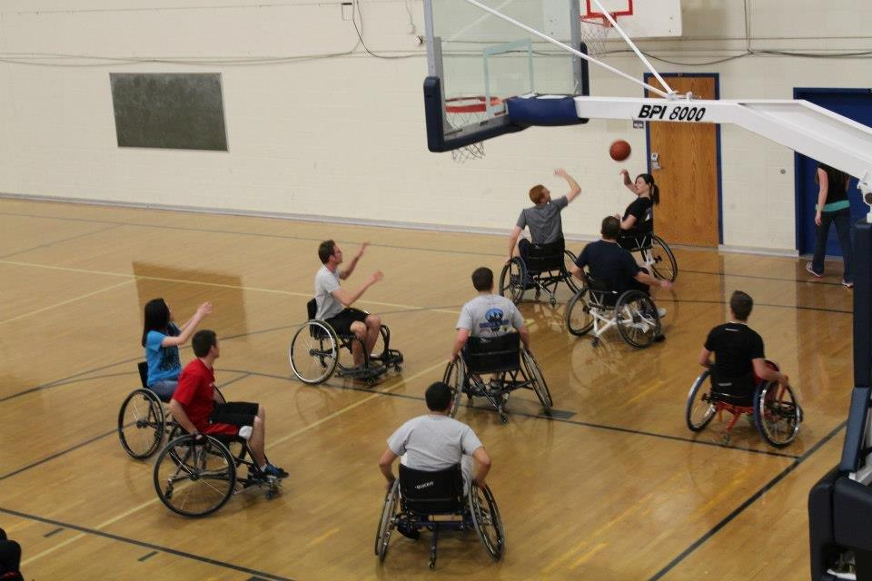 """Students play wheelchair basketball during Disability Awareness Week at BYU. Disability Awareness Week offers workshops, speakers and student activities. Students who want to play """"Murderball"""" can visit Room 136 RB Oct. 24 between 3 and 6 p.m. (GeriLynn Vorkink)"""