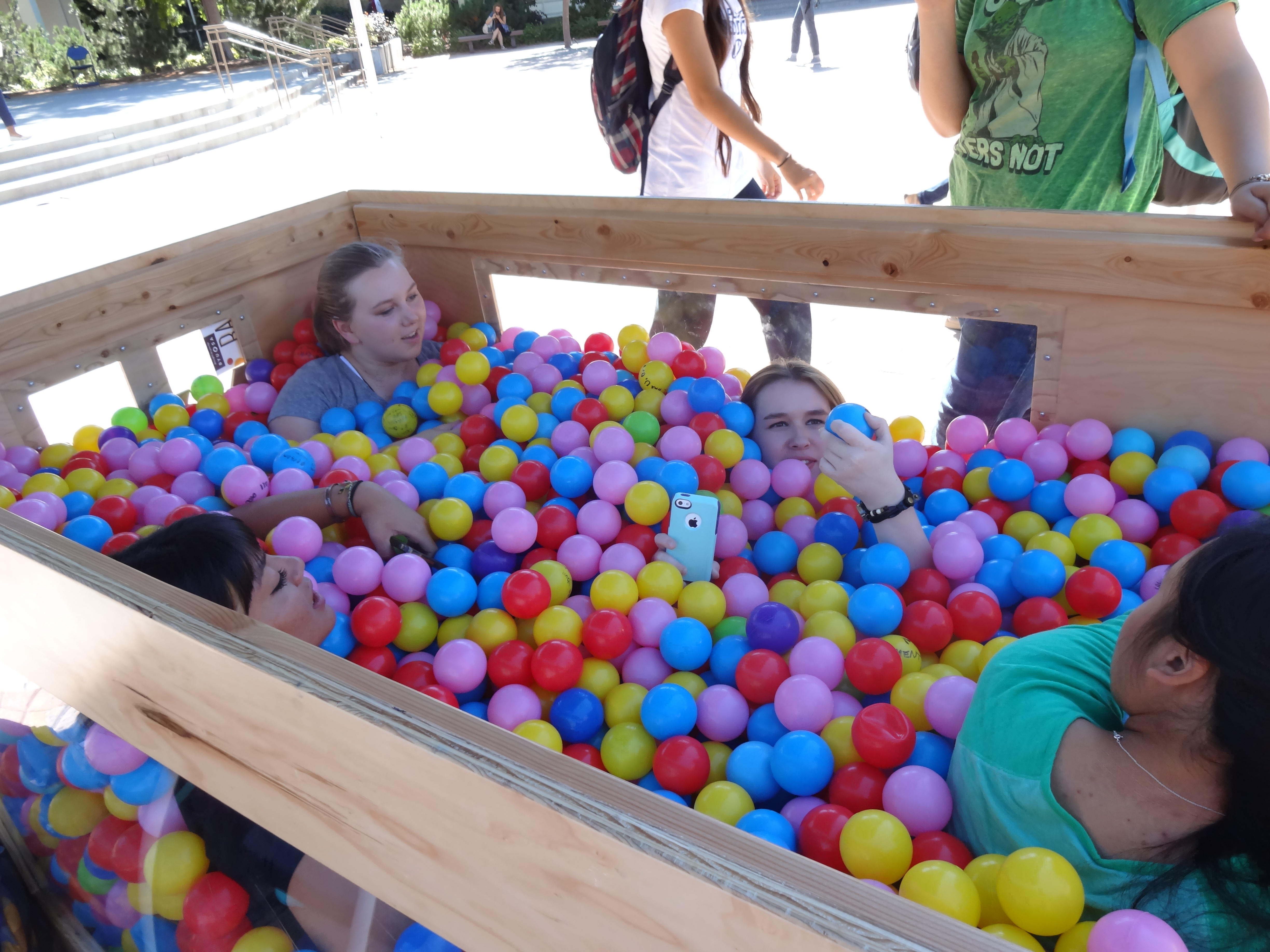 Students asking questions and getting to know each other in the ball pit at the Ball Pit Social. The Ball Put is brought to Brigham Square once a month to increase communication between students, faculty and friends. (Cara Wade)