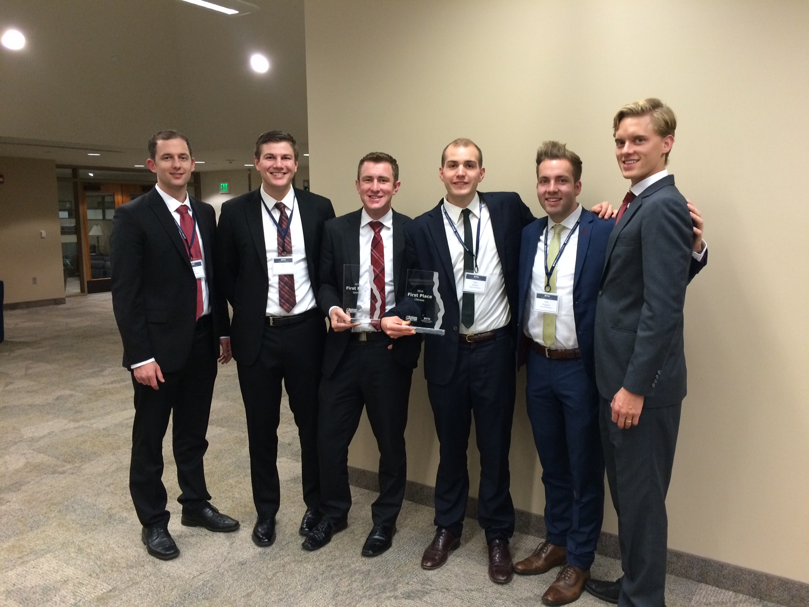 Gray , Travis Glock, Adam Long, Isaac Stevens, Seth Ferguson and Kindall Palmer pose with their winning plaques. The students made competed with the BYU Spanish and Chinese teams at the business case competition.  (Erica Palmer)
