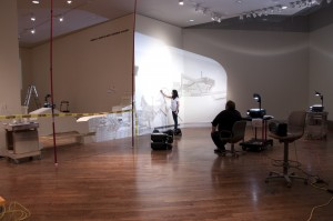 Artist Kim Schoenstadt starts drawing the projection of her artwork on the wall as Jeff Lambson watches. Schoenstadt and Lambson collaborated to bring the unique and personal exhibit to Provo. (BYU's Museum of Art)