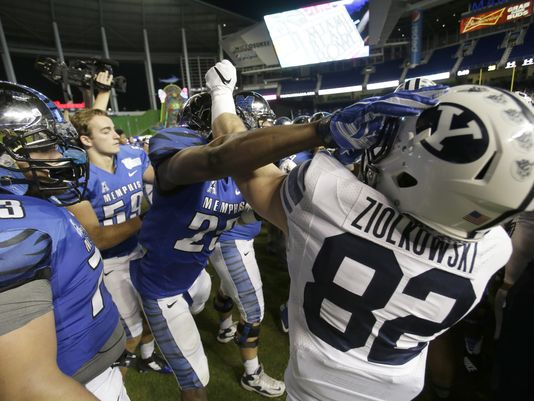 The brawl between BYU and Memphis after the Miami Beach Bowl. (AP Photo)