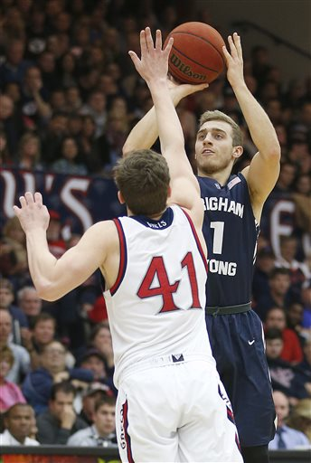 BYU guard Chase Fischer (1) shoots a 3-pointer over St. Mary's guard Emmett Naar during the first half of an NCAA college basketball game in Moraga, Calif., on Saturday, Jan. 17, 2015. (AP Photo/Tony Avelar)