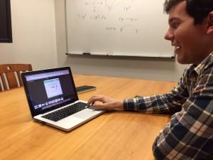 BYU neuroscience major David Hepworth shows how his chrome extension, Penny Pledge works. Penny Pledge recently won (Kasee Baldwin)