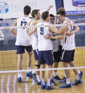 The Cougar volleyball team celebrates after scoring a point against Long Beach State. (Bryan Pearson)