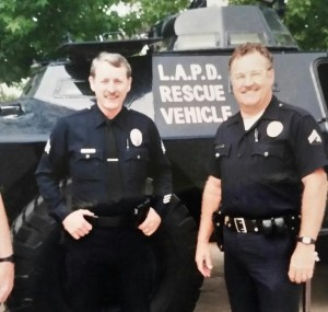 Carl Whiting and one of his co-workers pose in front of an Los Angeles Police Department rescue vehicle. Whiting held 10 different positions in the LAPD, arresting child abusers, gang members, pimps and rapists. (Carl Whiting)