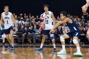 Jaylen Reyes volleys the ball as Price Jarman (1) and Brenden Sander (15) look on. (Ari Davis)