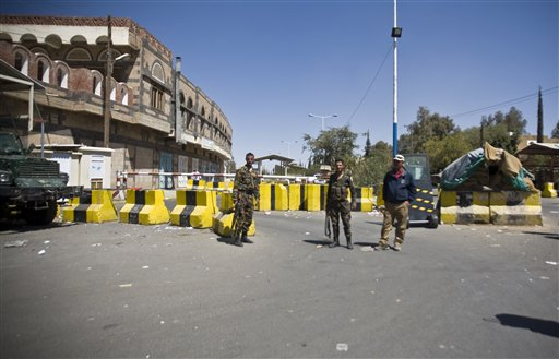 Police troopers stand guard at the entrance of the U.S. Embassy in Sanaa, Yemen, Wednesday, Feb. 11, 2015. The State Department has closed the U.S. Embassy in Yemen and evacuated its staff because of the political crisis and security concerns following the takeover of much of the country by Shiite rebels. (AP Photo/Hani Mohammed)