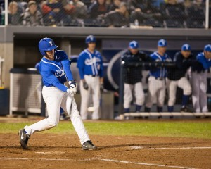 BYU Baseball player gets a hit against Pepperdine on March 13.