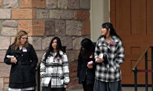 Missionaries wait outside the Salt Lake Tabernacle for visitors. (Lauren Buchanan)