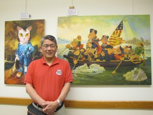 "Shu Yamamoto stands next to his painting ""Catshington Crossing the Delaware,"" based off of Emanuel Leutze's famous painting. (Sara Bitterman)"