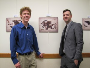 Josh Cotton (left) and Jesse Draper (right) pose next to their art at the exhibit. (Sara Bitterman)