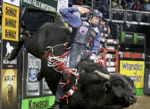 Kasey Hayes rides Shaft during the Professional Bull Riding Tour stop at the Denny Sanford Premier Center on March, 13, 2015 in Sioux Falls, S.D. Serious injuries are occupational hazards for bull riders, but doctors, riders and researchers say the most pervasive injuries are concussions. The Professional Bull Riders' circuit provides a stable of doctors, requires helmets for anyone born after 1994 and insists concussed riders pass a test before getting back in the saddle. (AP Photo/Dave Eggen)