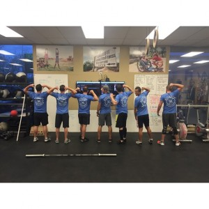 CrossFit members show off their matching shirts to feel more unified during their workouts. CrossFit gyms around the country boast of the undeniable community culture. (CrossFit SpearHead)