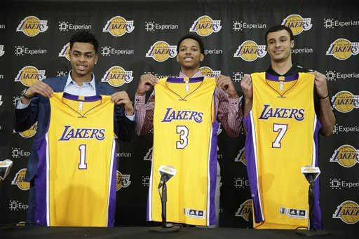 From left, Los Angeles Lakers new draft picks, D'Angelo Russell, Anthony Brown and Larry Nance pose with their jerseys during a news conference, Monday, June 29, 2015, in El Segundo , Calif. (AP Photo/Jae C. Hong)