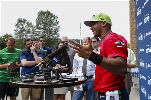 Seattle Seahawks quarterback Russell Wilson answers questions during a press conference following an NFL football minicamp Thursday, June 18, 2015, in Renton, Wash. (AP Photo/Joe Nicholson)
