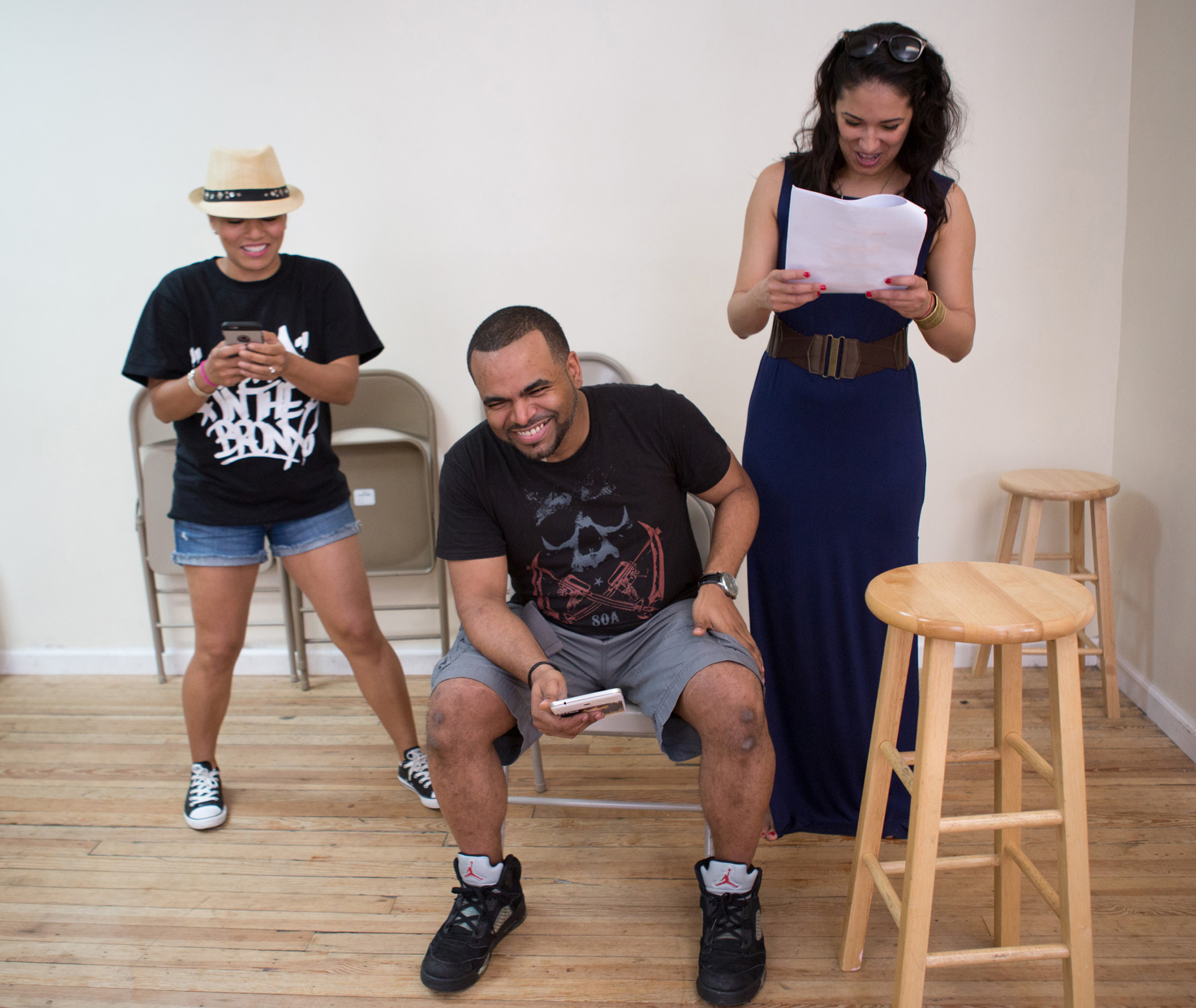 In this June 14, 2015 photo, members of the Latino sketch comedy group Room 28, from left, April Hernandez, Jerry Diaz and Ariana Rodriguez, rehearse at their studio in New York. The actors in the group are preparing for their next performance June 26 and 27 at the Davenport Theatre in New York. (AP Photo/Kevin Hagen)