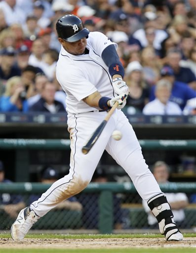 Detroit Tigers' Miguel Cabrera singles against the Toronto Blue Jays to drive in Yoenis Cespedes during the fourth inning of a baseball game Friday, July 3, 2015, in Detroit. (AP Photo/Duane Burleson)