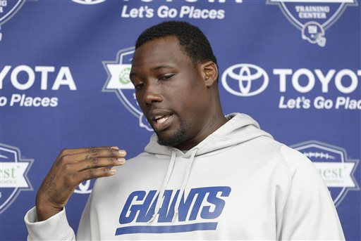 FILE - This is a July 24, 2014, file photo showing New York Giants' Jason Pierre-Paul talking to reporters during an NFL football camp in East Rutherford, N.J. The Giants are aware of an incident involving Jason Pierre-Paul and fireworks, but the team is unsure about the severity of any injuries to the star defensive end, a person with knowledge of the incident tells The Associated Press on Monday, July 6, 2015. The person spoke on condition of anonymity because no information has been released publicly. (AP Photo/Seth Wenig, File)