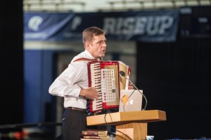 Education Week presenter J.B. Haws entertains his youth audience with the accordian. Haws taught youth how to forget themselves and focus on others.