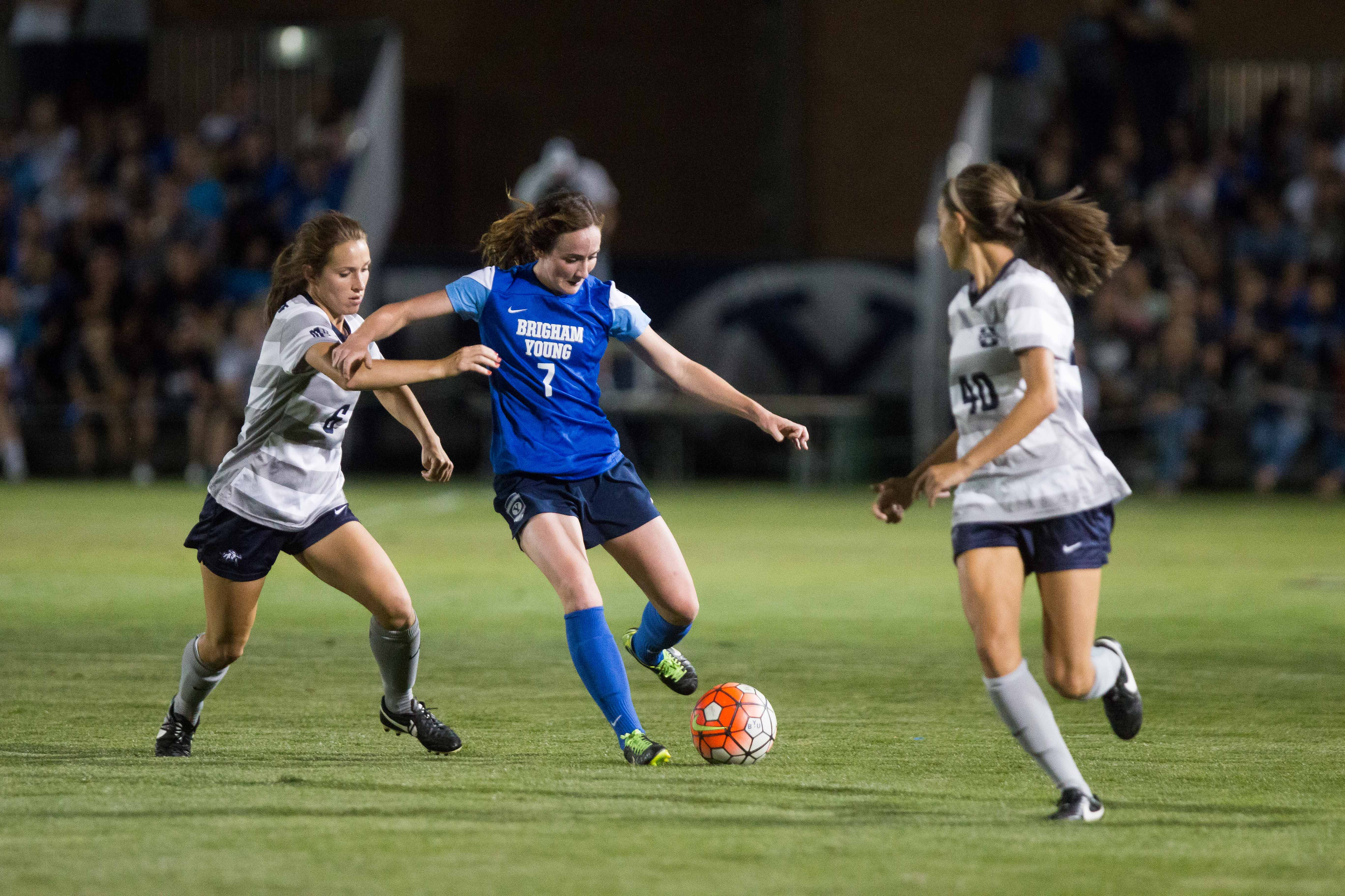 Michele Murphy Vasconcelos passes the ball  in the game against Utah state University. Murphy Vasconcelos earned the WCC player of the week award due to her double-assists against Long Beach State on Saturday. (Ari Davis)