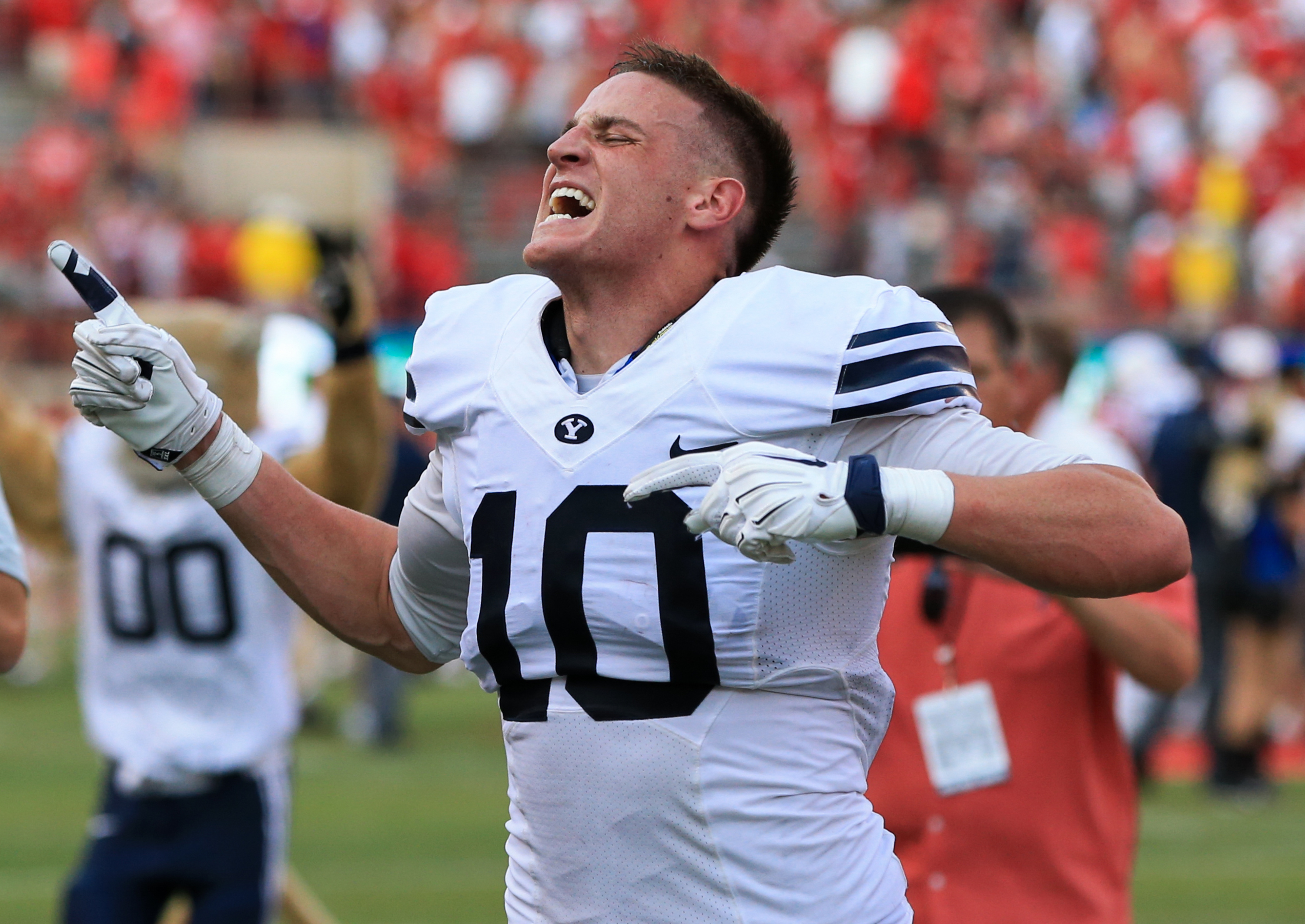 BYU wide receiver Mitch Mathews (10) reacts after catching the game-winning touchdown against Nebraska following the second half of an NCAA college football game in Lincoln, Neb., Saturday, Sept. 5, 2015. BYU won 33-28. (AP Photo/Nati Harnik)