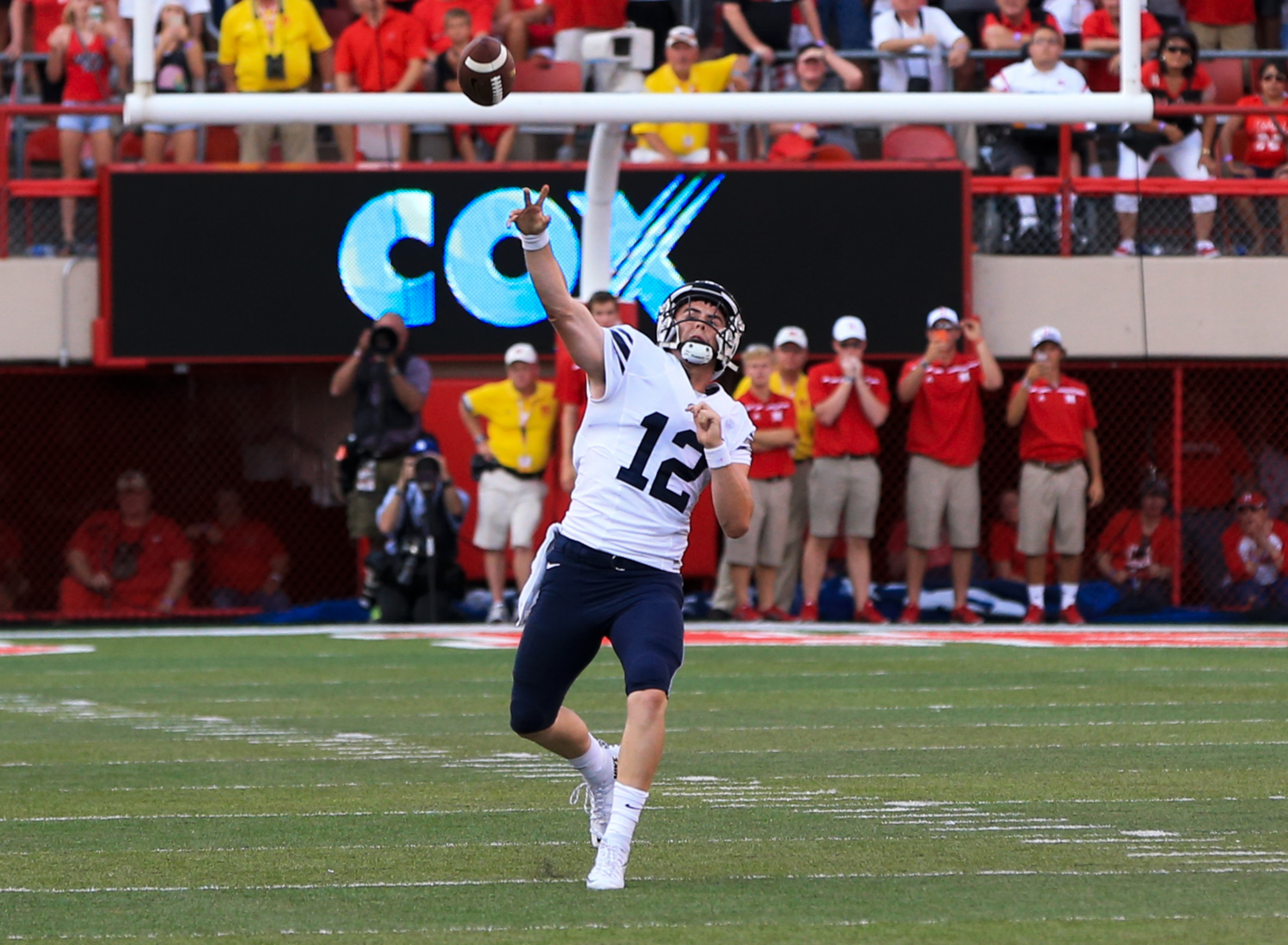BYU quarterback Tanner Mangum throws a 42-yard Hail Mary with no time left, which was caught for the game-winning touchdown by wide receiver Mitch Mathews, unseen, giving BYU a 33-28 victory over Nebraska. (AP Photo/Nati Harnik)