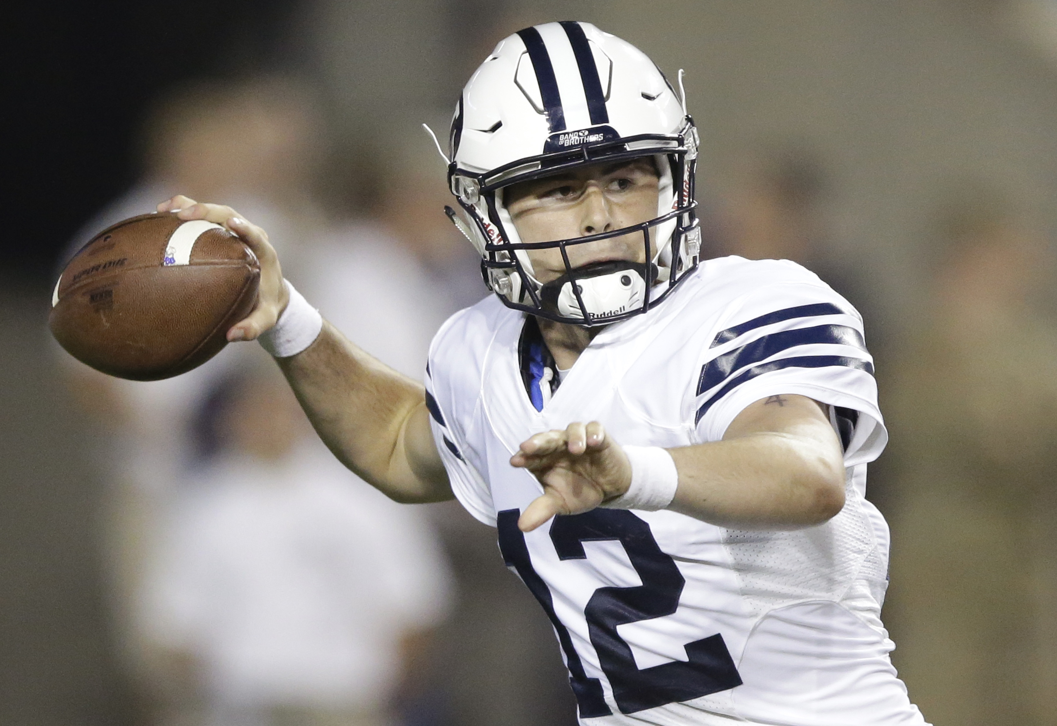 BYU quarterback Tanner Mangum passes during the first half of the victory against Boise State. The Cougars won 35-24. (Associated Press)