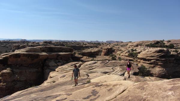 Hikers trek through Needles, Utah. (Twitter)